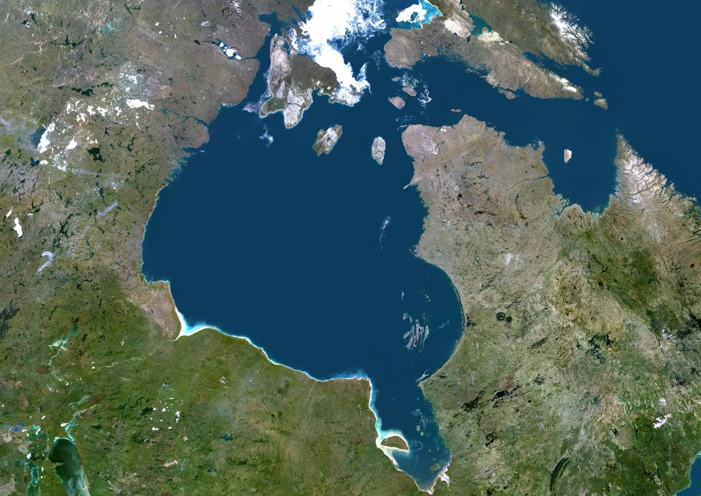 Hudson Bay, Canada, True Colour Satellite Image. True colour satellite image of Hudson Bay, a large body of water in northeastern Canada. A smaller offshoot of the bay, James Bay, lies to the south. North of Hudson Bay is Southampton island and westnorth is Baffin island. One group of islands in the southeast of the bay is the Belcher Islands. Composite image using LANDSAT 5 data. : Stock Photo