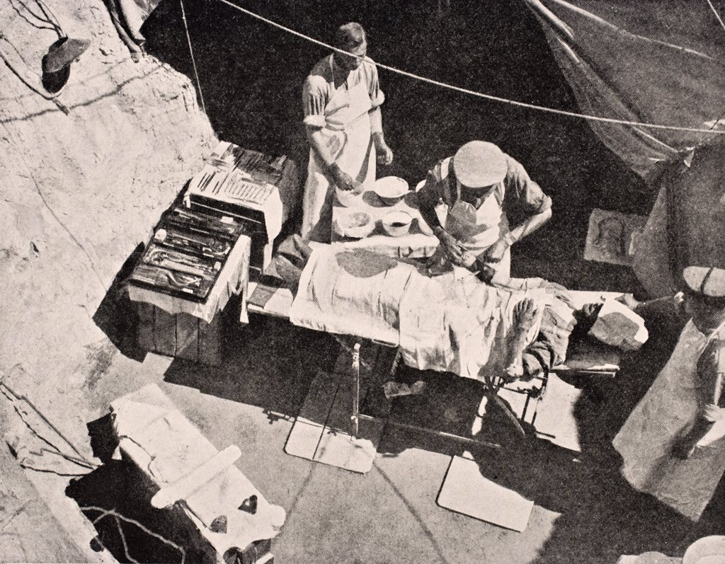 Field surgery on Gallipoli Peninsula Turkey 1915 Surgeon is removing bullet from arm of soldier From The War Illustrated Album deLuxe published London 1916 : Stock Photo
