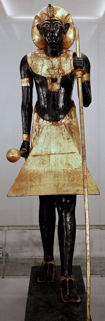 Egyptian Antiquities: The Royal Ka, guardian spirit of Tutankhamun. Red wood and guilded bronze, H54 cm, 18th Dynasty, c. 1340 BC. From the Tomb of Tutankhamun, Valley of the Kings, Thebes. Egyptian Museum, Cairo, Egypt.  : Stock Photo