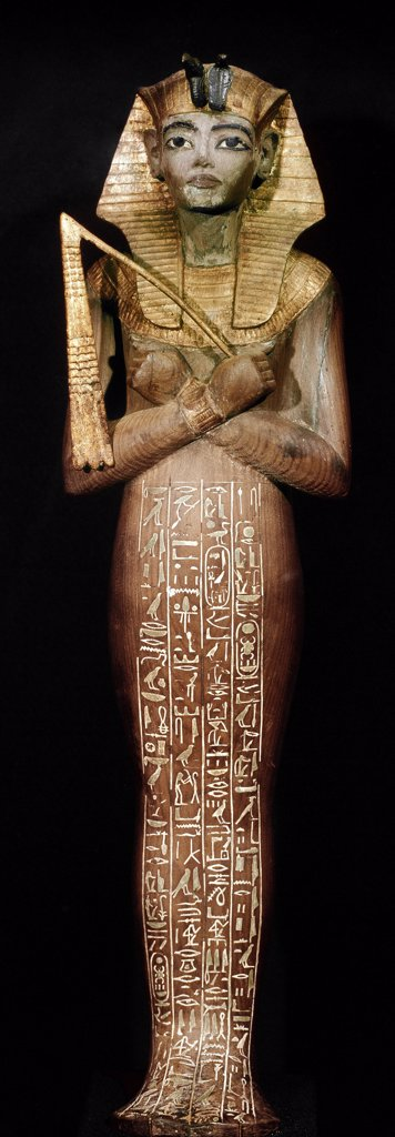 Egyptian Antiquities: Ushebti figure (servant of the defunct in the hereafter). Wood, 18th Dynasty, c.1340 BC. From the Tomb of Tutankhamun, Valley of the Kings, Thebes. Egyptian Museum, Cairo, Egypt.  : Stock Photo