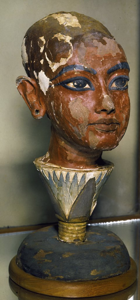 Egyptian Antiquities: Painted bust of young Pharaoh Tutankhamun with lotus leaf shaped base. Painted wood, New Kingdom, 18th Dynasty, c.1340 BC. Treasure from the tomb of Tutankhamun, Valley of the Kings, Thebes. Egyptian Museum, Cairo, Egypt .  : Stock Photo
