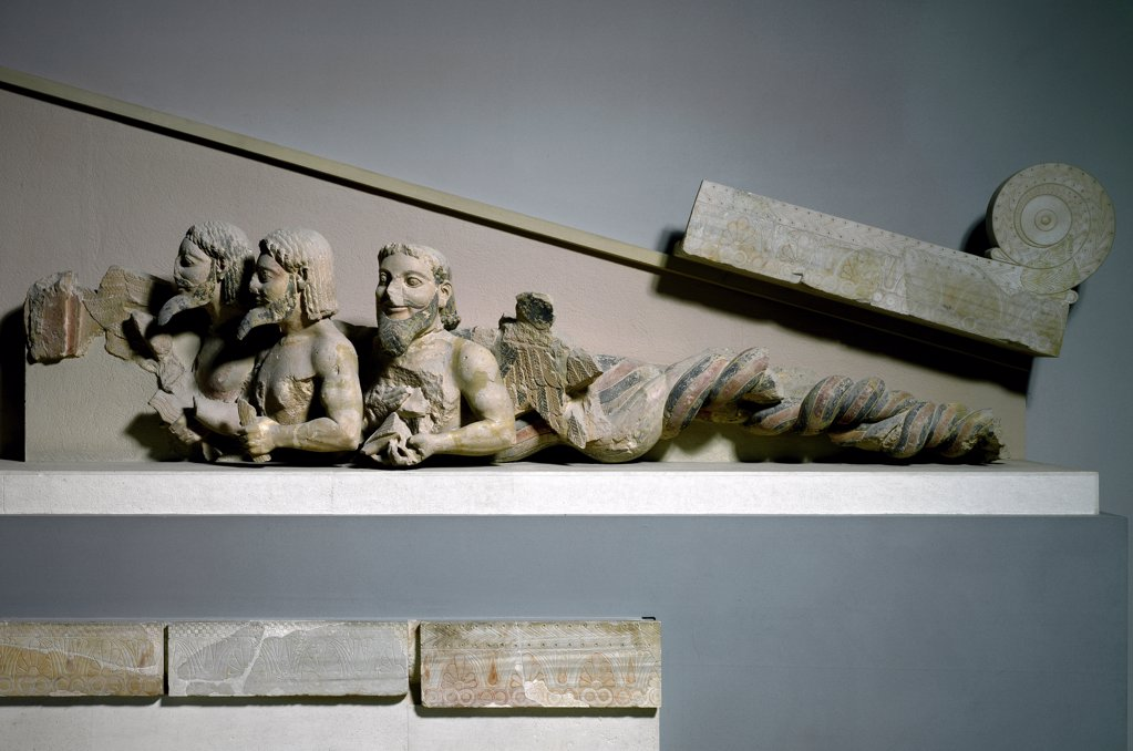 Greek Art: Triple-Bodied Monster. From the west pediment of the Hekatompedon Temple (or the old Temple of Athena), representing Herakles wrestling with Triton. Limestone, c.570-550 BC. Acropolis Museum, Athens, Greece.  : Stock Photo