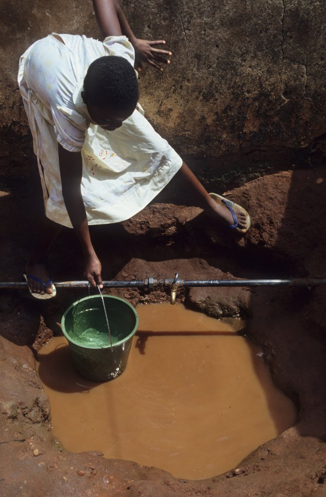 Stock Photo: 1899-43739 COLLECTING WATER, NIGERIA. From a well. .