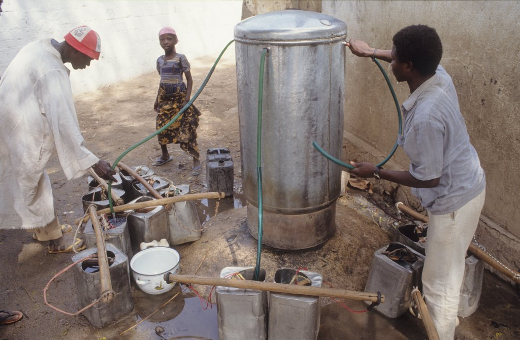 DOMESTIC WATER, CAMEROON. Maroua City. Collecting water from a municiple pump. .  : Stock Photo
