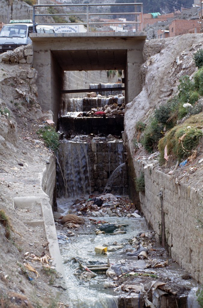 BOLIVIA - COCHABAMBA CITY. An open sewer-system on the outskirts of town. .  : Stock Photo