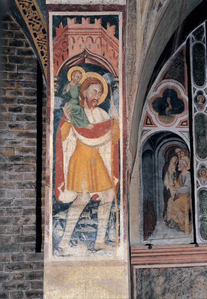 St Christopher, by Veneto Artist, 14th Century, fresco. Italy: Veneto: Treviso: Santa Lucia church. Whole artwork. St Christopher walls red yellow Infant Jesus/Christ Child/Baby Jesus/Child Jesus bearer : Stock Photo