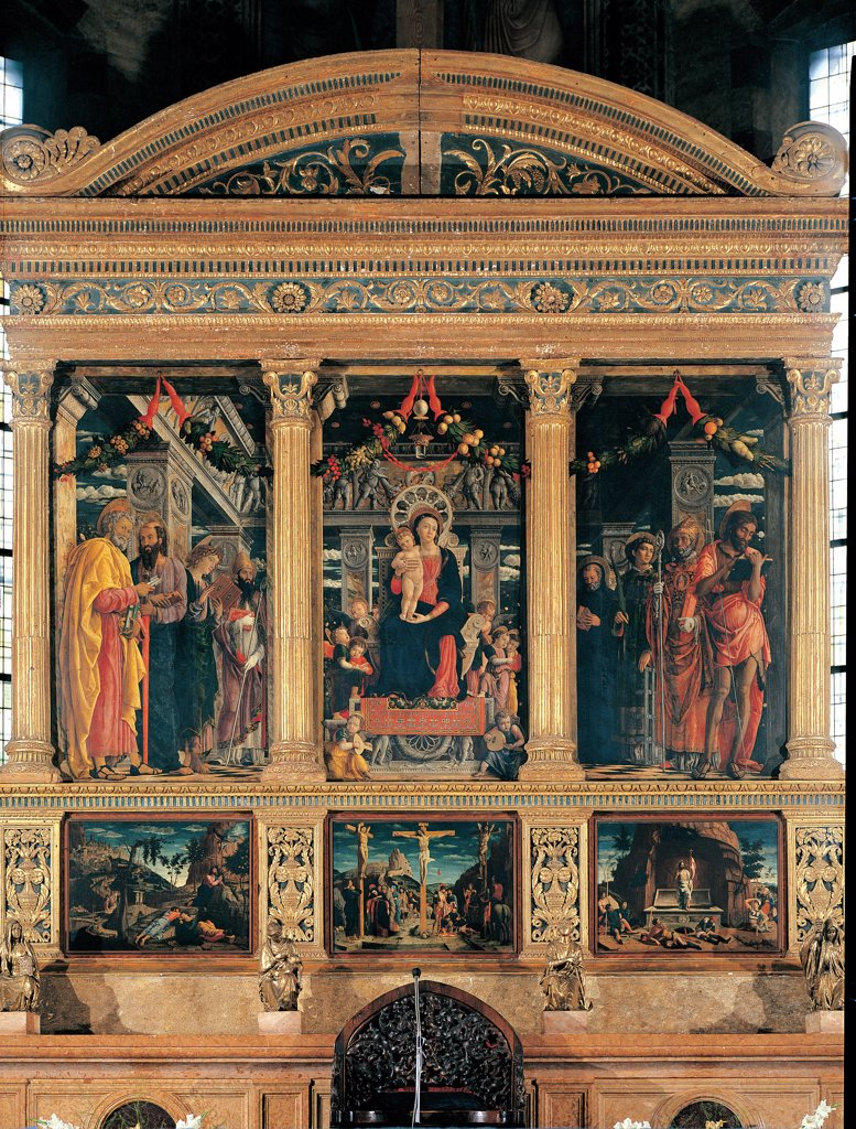 San Zeno Altarpiece (Holy Conversation), by Mantegna Andrea, 1456 - 1459, 15th Century, tempera on panel, polyptych, gilded frame. Italy. Veneto. Verona. San Zeno Maggiore basilica. altar. Whole artwork. Polyptych, wooden golden frame/cornice, only the triptych of the Sacred Conversation is original, predella with copies of of Prayer in the Garden, The Crucifixion, The Resurrection : Stock Photo