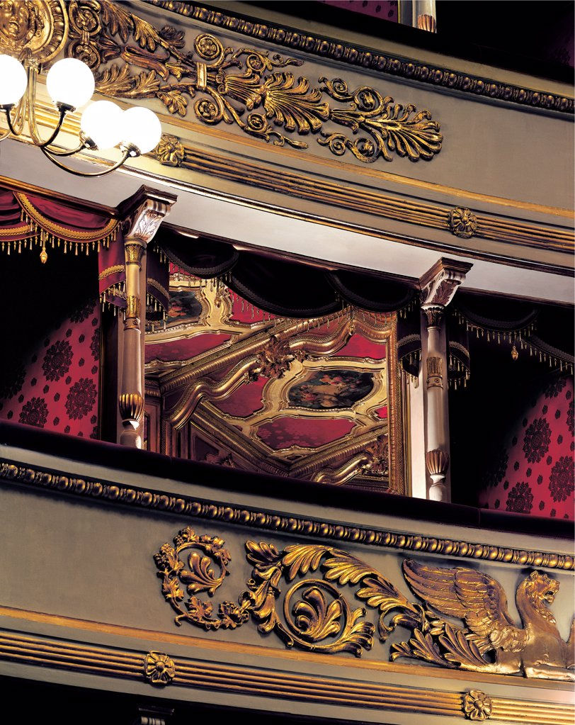 Views of the Teatro alla Scala, Milan, after its restoration in 2004, by Piermarini Giuseppe, 2004, 21st Century, . Italy: Lombardy: Milan: Teatro alla Scala. Detail. Gold frame/cornice box red ceiling chandelier : Stock Photo