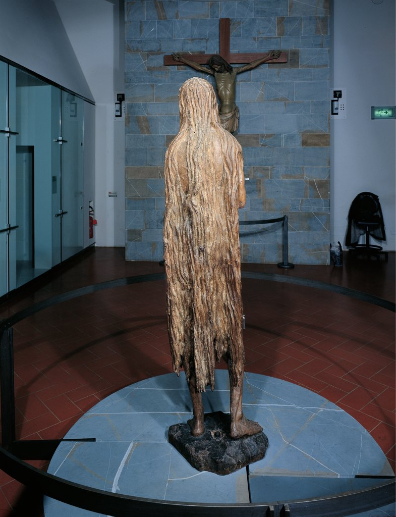 St Mary Magdalene, by Donato di Niccolo di Betto Bardi known as Donatello, 1453 - 1455, 15th Century, wood carved, gilded and painted. Italy: Tuscany: Florence: Opera di Santa Maria del Fiore Museum. Whole artwork. From behind back woman Mary Magdalene statue long hair : Stock Photo