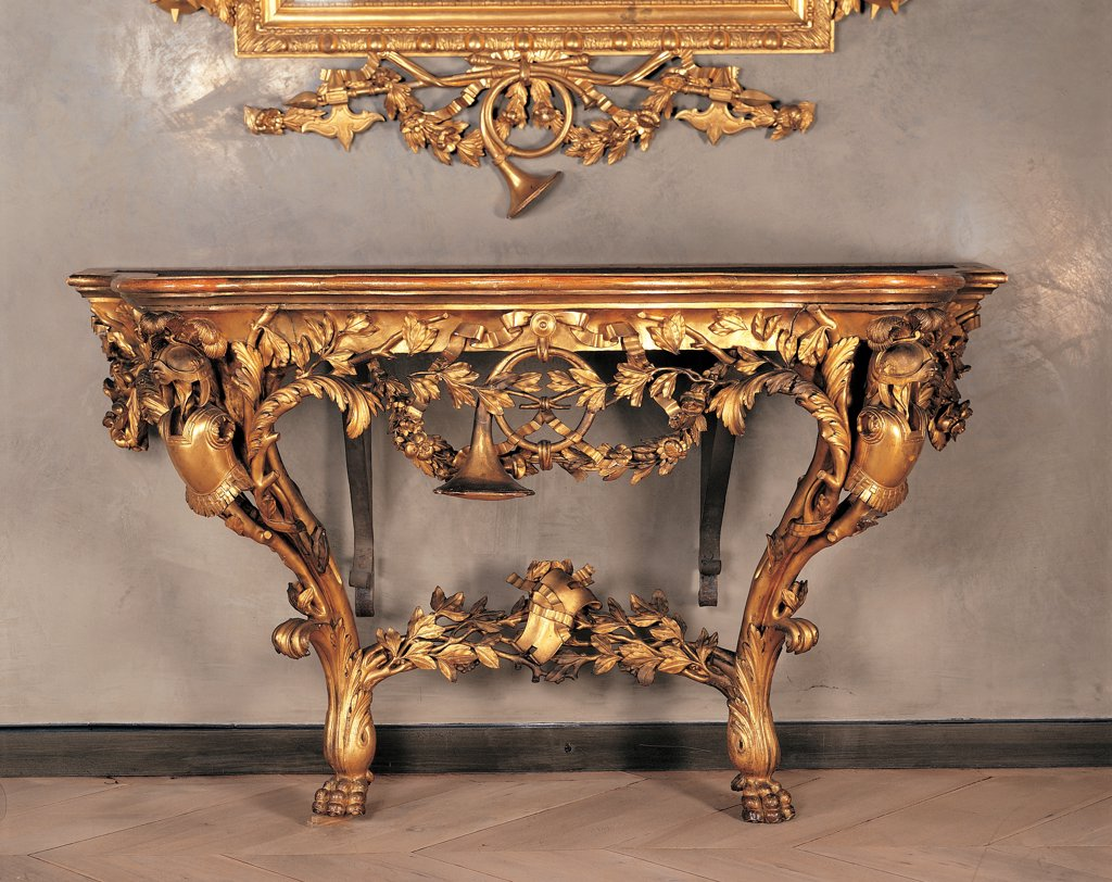 Console, by perhaps by Marchetti Ignazio, 1770, 18th Century, wood carved and gilded. Italy: Emilia Romagna: Parma: National Gallery of Art. Front view wall table console gold phytomorphic motifs gilded wood cuirass bugle-horn lion's protomes : Stock Photo