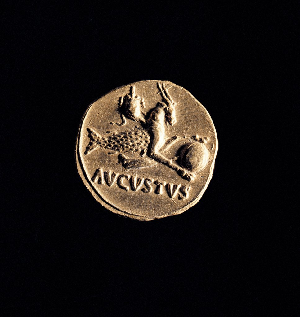 Coin (Augustus Aureus), by Unknown artist, 18 - 16,, gold. Italy: Lazio: Rome: Palazzo Massimo alle Terme. Reverse portraying the Capricorn zodiac sign with the inscription AUGUSTUS. On the right side the head profile probably of Augustus : Stock Photo