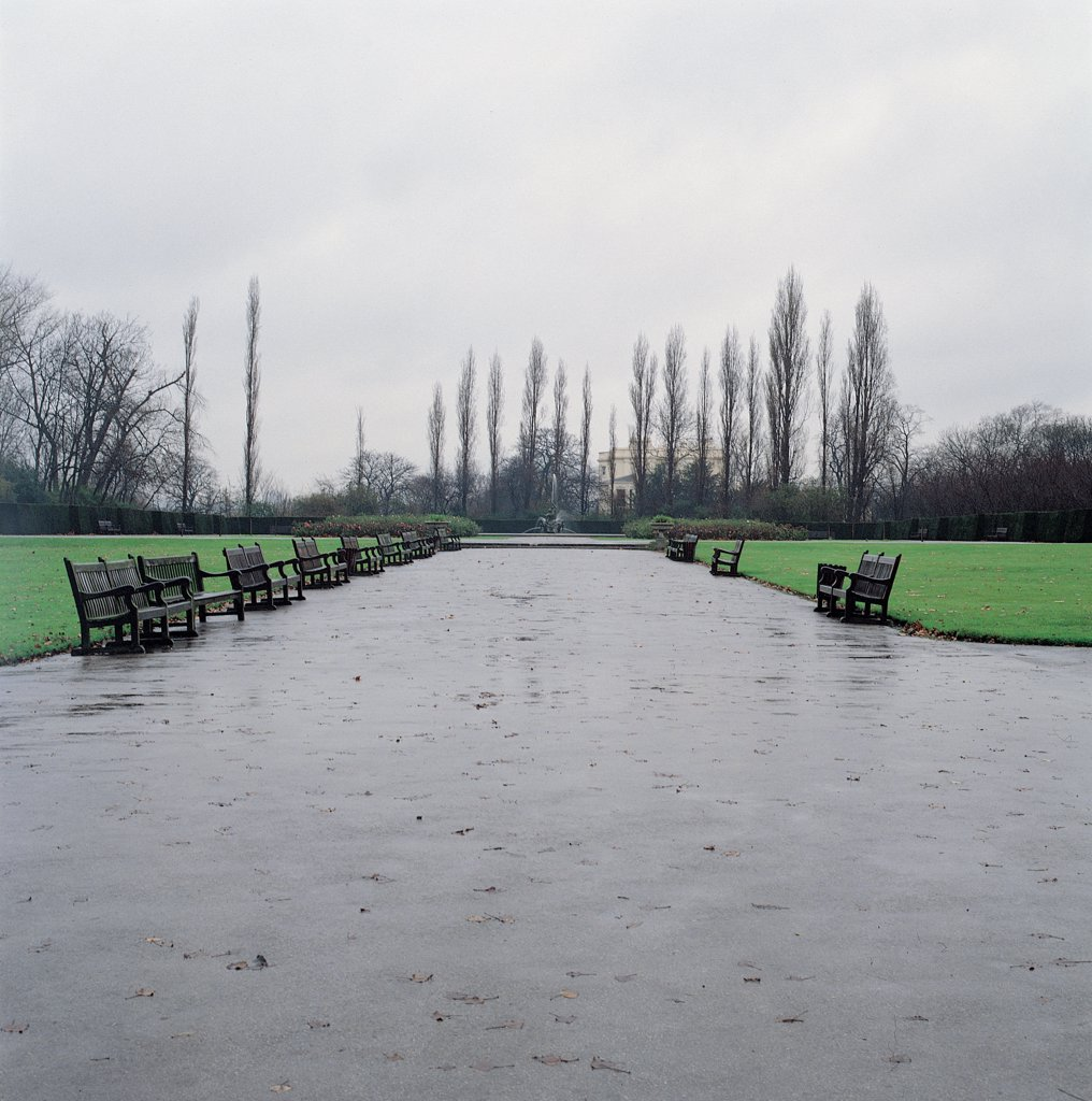 Regent's Park, by Nash John, 19th Century, . United Kingdom: England: London: London: Regent's Park. Regent's Park view park path benches bare trees rain puddles : Stock Photo