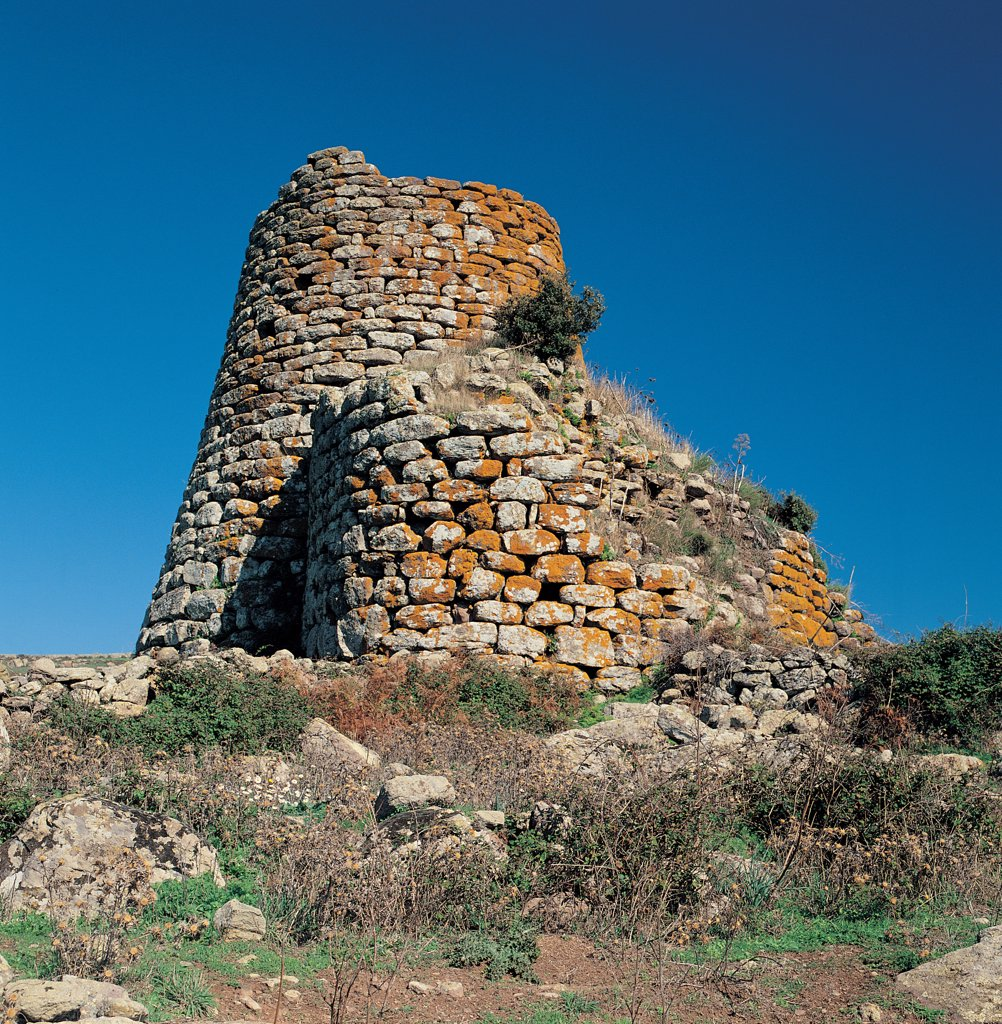 Stock Photo: 1899-45588 Nuraghe at S'Orolo, by Unknown artist, 8th Century b.C., 2nd Century a.D., . Italy: Sardegna: Nuoro: Bortigali. View of nuraghe at St Orolo trilobate central tower tholos wall bastion large squared basalt blocks