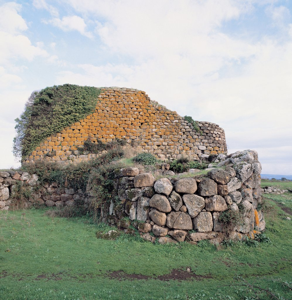 Stock Photo: 1899-45592 Nuraghe at Losa, by Unknown artist, 8th Century b.C., 2nd Century a.D., . Italy: Sardegna: Oristano: Abbasanta. View Nuraghe Losa bastion large hut slits green meadow wall rock