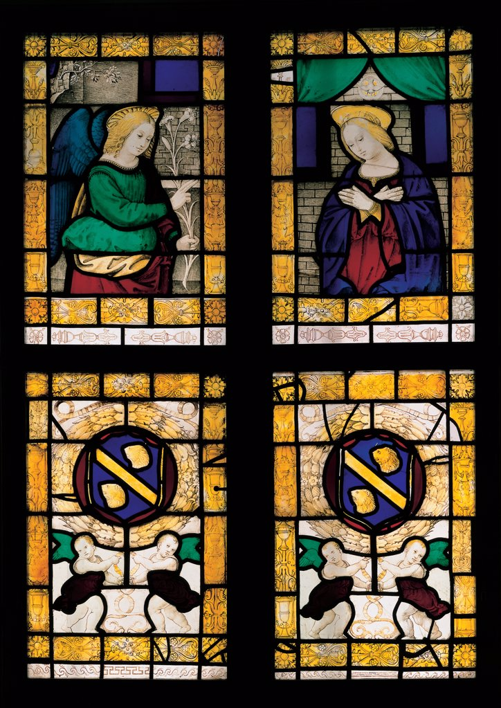 The Annunciation and Guidalotti coat of arms, by Viti Timoteo, 1518 - 1523, 16th Century, polychrome window grisaille painted. Italy: Marche: Pesaro Urbino: Urbino: Galleria Nazionale delle Marche. Whole artwork. Window panels Annunciation Virgin lady Annunciation Mary halo dove Holy Spirit archangel Gabriel announcement lily purity coats-of-arms garland putti frame grotesques yellow green blue : Stock Photo