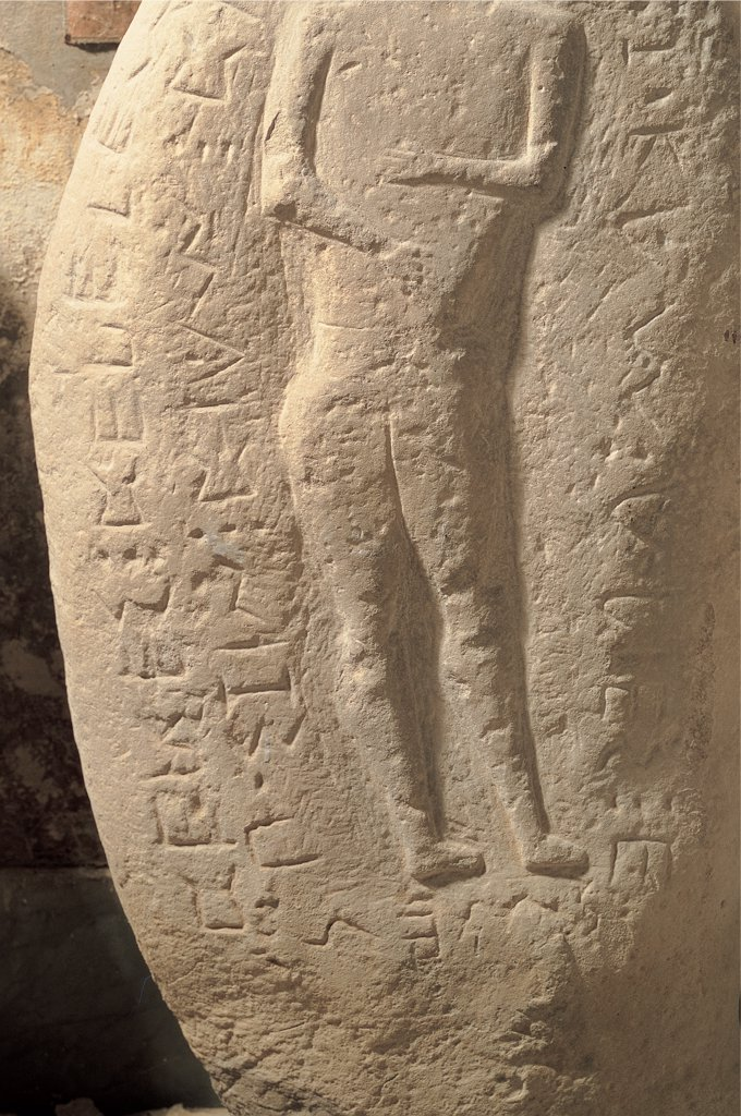 Stock Photo: 1899-45775 Stele of Bellante, by Unknown artist, 6th Century, bas, relief, sandstone. Italy: Campania: Naples: National Archaeological Museum. Detail. Carved funeral stele carved bas-relief deceased man Thetys Halios legs buttocks back inscription Sabellian language