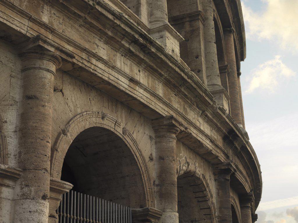Flavian Amphitheatre or Coliseum in Rome, by Unknown artist, 79 - 80, 1st Century, brick and travertine stone. Italy: Lazio: Rome: Coliseum. Detail. Exterior Coliseum arches cornice Flavian amphitheatre : Stock Photo