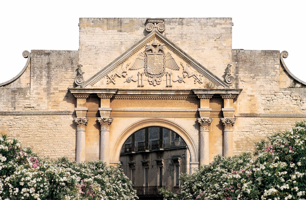 Stock Photo: 1899-46640 Triumphal Arch of Charles V, Lecce (Porta Napoli), by Dell'Acaya (o Acaja) Gian Giacomo, 1548, 16th Century, Lecce stone. Italy: Puglia: Lecce: Lecce: Triumphal Arch of Charles V: Porta Napoli. Urban/city view city Lecce gate triumphal arch of Charles V Porta Napoli (Naples Gate) round barrel vault/arch/supporting arch Corinthian-style coupled columns smooth/polished/plain shaft triangular fronton/pediment sculptured tympanum coat of arms two-he