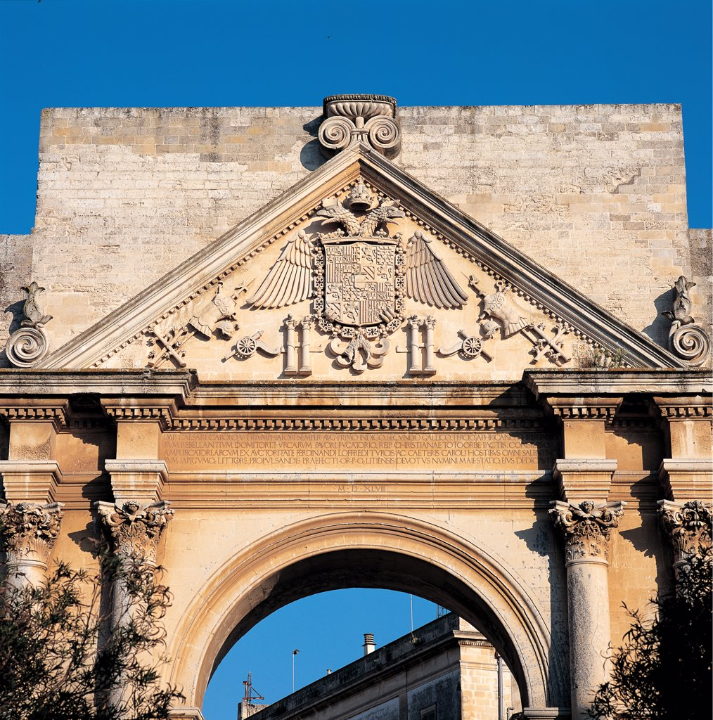 Stock Photo: 1899-46641 Triumphal Arch of Charles V, Lecce (Porta Napoli), by Dell'Acaya (o Acaja) Gian Giacomo, 1548, 16th Century, Lecce stone. Italy: Puglia: Lecce: Lecce: Triumphal Arch of Charles V: Porta Napoli. Detail. Town gate Charles V Triumphal Arch Porta Napoli Naples Gate arch round arch Corinthian-style paired columns smooth shaft/trunk triangular pediment carved tympanum/gable heraldic crest/coat of arms two-headed eagle Habsburg family Imperial crest/coat of arms commemorative inscriptions cornice denti