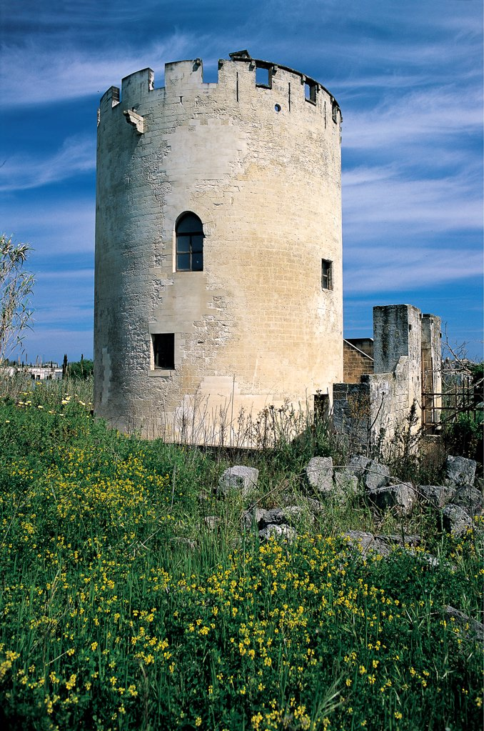 Stock Photo: 1899-46646 Torre di Belloluogo near Lecce, by Unknown artist, 14th Century, . Italy: Puglia: Lecce: Lecce: Torre di Belloluogo. Whole artwork. Exterior Belloluogo Tower Lecce round donjon large tower battlement/crenellations merlons fortifications windows