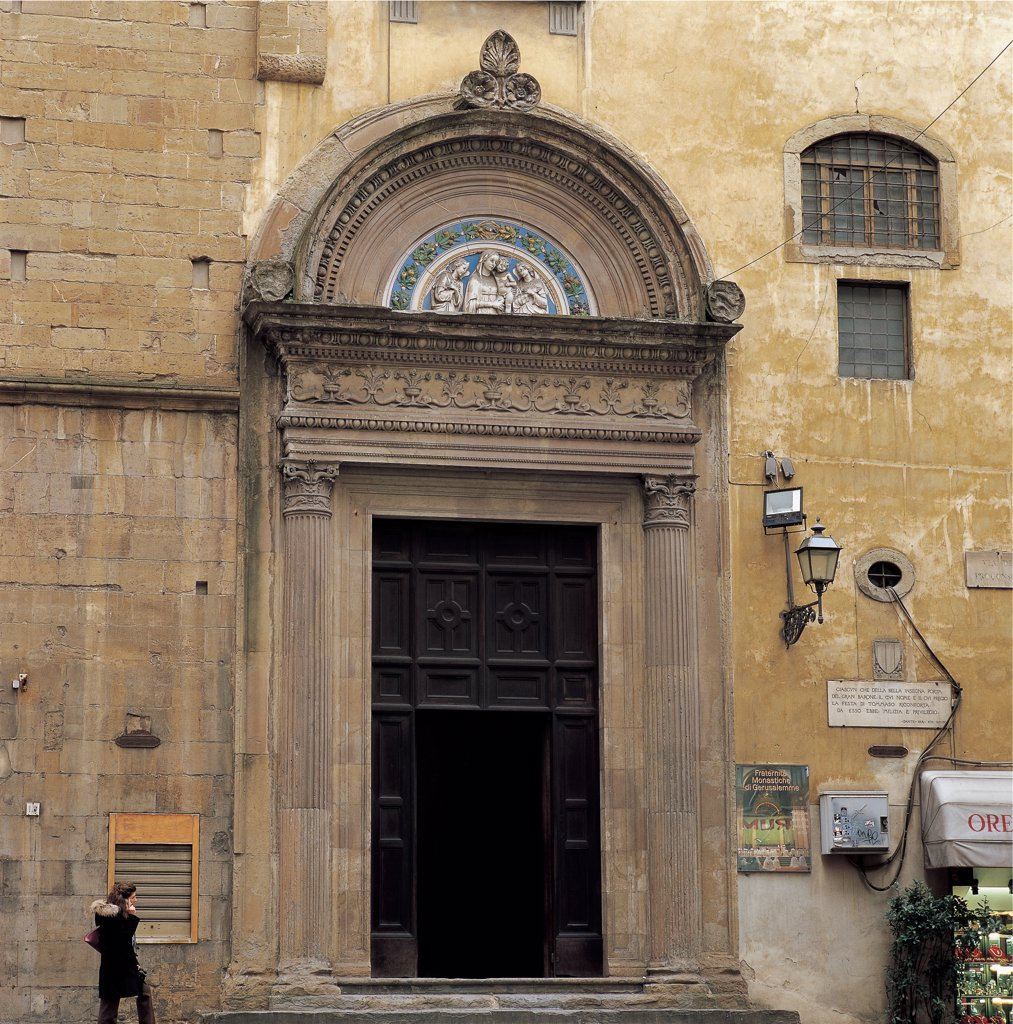 Stock Photo: 1899-46694 Badia Fiorentina, by Unknown artist, 978, 10th Century, . Italy: Tuscany: Florence: Badia Fiorentina. View Badia Fiorentina detail front/facade portal/doorway tympanum via Proconsolo road/street door/entrance