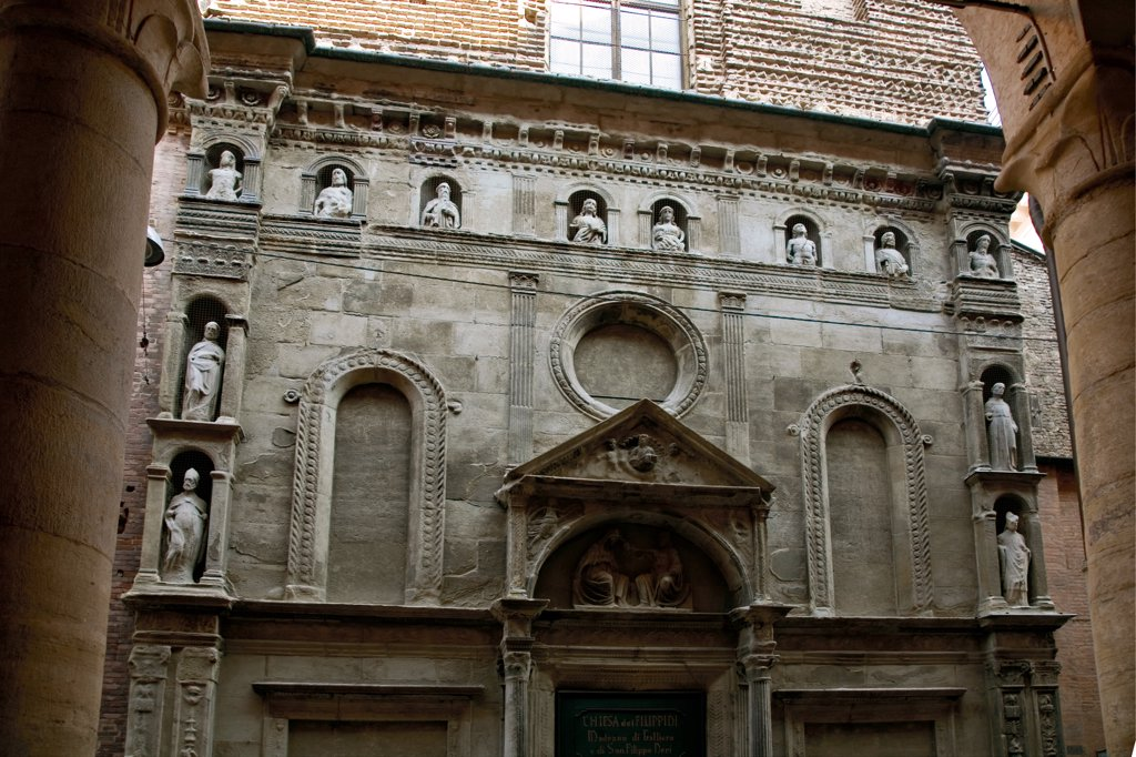 Stock Photo: 1899-46826 Church of Santa Maria di Galleria, by Unknown artist, 15th Century, . Italy: Emilia Romagna: Bologna: Santa Maria di Galleria church. Detail. Facade church doorway entrance lunette tympanum Virgin Mary Madonna side niches saints prophets oculus