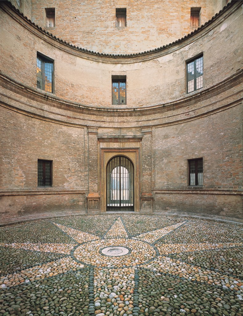 Mantegna's House on Via Acerbi, Mantua, by perhaps by Mantegna Andrea, 1476, 15th Century, . Italy: Lombardy: Mantua: Mantegna's House. Detail. Round courtyard Mantegna's house Mantua bricks cornice string-course paving pebbles star circle doorway : Stock Photo