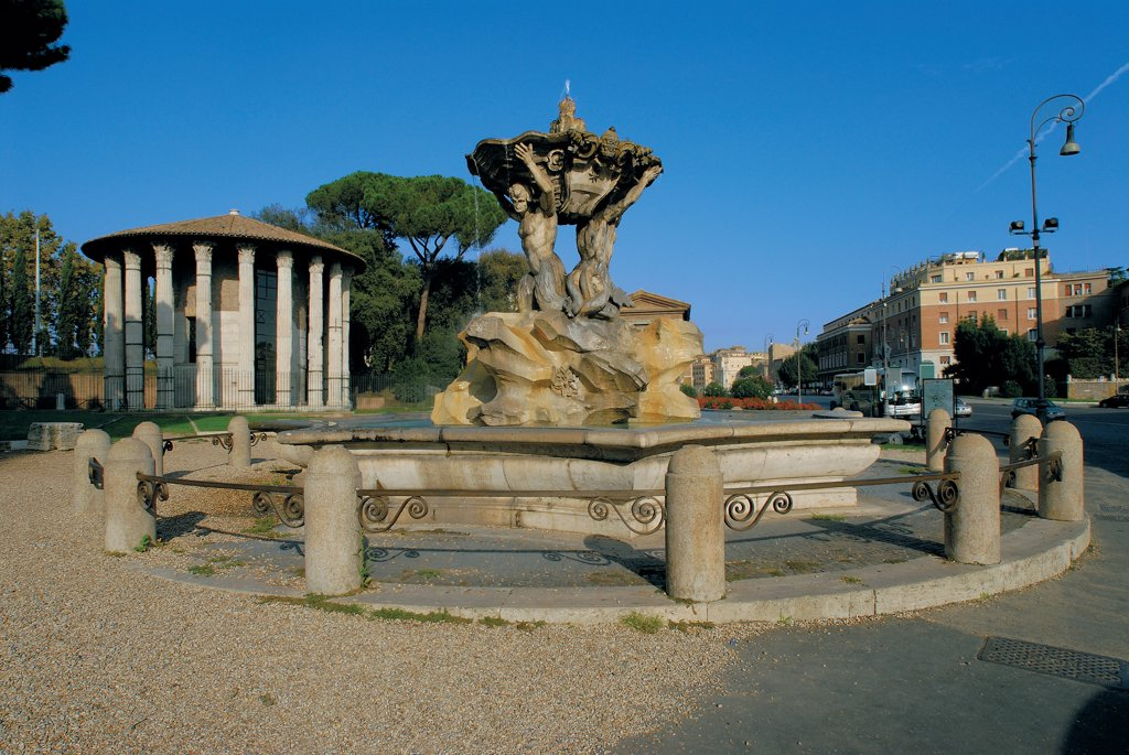 Fountain of Tritons in Piazza della Bocca della Verita, by Unknown artist, 1717, 18th Century, . Italy: Lazio: Rome: Piazza Bocca della Verita. View fountain of Tritons piazza della Bocca della Verita Rome basin pond Vesta temple : Stock Photo
