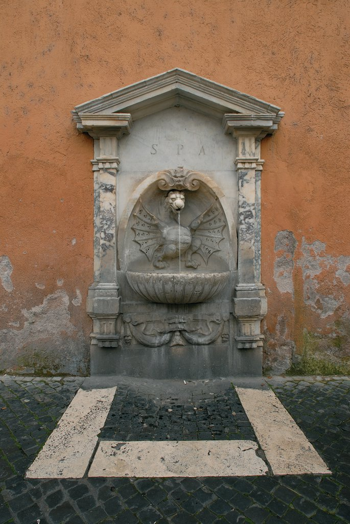 Fountain in Via Conciliazione, by Unknown artist, 17th Century, . Italy: Lazio: Rome: Via della Conciliazione. View fountain basin shell dragon aedicule festoon : Stock Photo