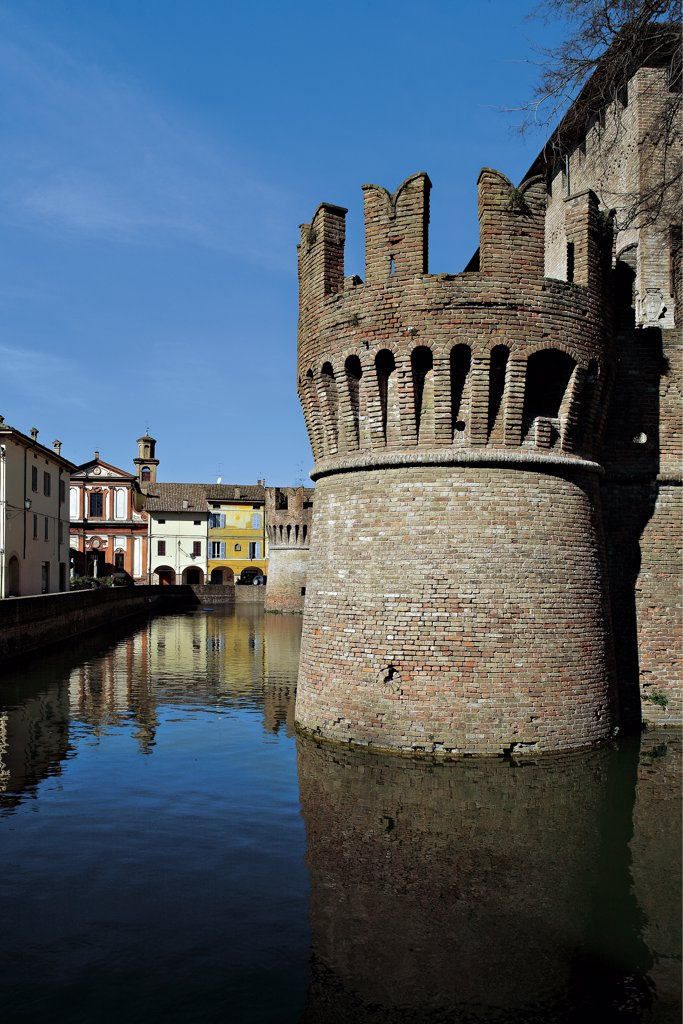 Stock Photo: 1899-47053 Fontanellato Castle, by Unknown artist, 1384, 14th Century, . Italy: Emilia Romagna: Parma: Fontanellato. View of Fontanellato Castle square tower crenellated walls moat houses reflections in the water
