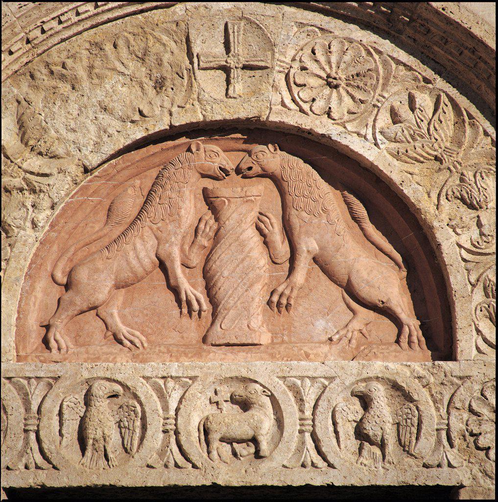 Stock Photo: 1899-47178 Cathedral of San Rufino, by Alessi Galeazzo, Giovanni da Gubbio, 1140, 12th Century, . Italy: Umbria: Perugia: San Rufino cathedral. Detail. Facade church cathedral of San Rufino doorway lunette animals roundels lamb (eagle) dove lions rampant plant motifs