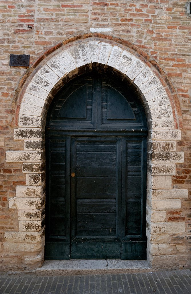 Stock Photo: 1899-47364 Oratory of Santa Croce, by Unknown artist, 1317, 14th Century, . Italy: Marche: Pesaro Urbino: Urbino: Santa Croce Oratory. Portal/doorway ogival arch/pointed arch/lancet arch front/facade in Via Santa Croce Oratory of Santa Croce bricks