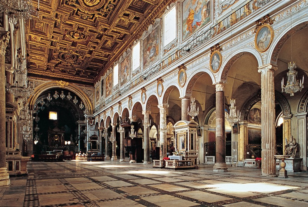 Church of Santa Maria in Aracoeli, by Unknown, 7th Century, Unknow. Italy, Lazio, Rome, Santa Maria in Aracoeli Basilica. View of church interior nave and two side-aisles rounded arches re-used Ionic and Corinthian capitals Cosmatesque polychrome marble floor walls of nave decorated with 17C frescoes depicting the Life of the Virgin Mary. : Stock Photo