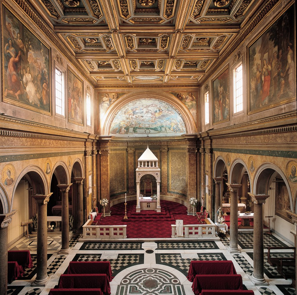 Church of Sant'Agata dei Goti, by Unknown, 5th Century, Unknow. Italy, Lazio, Rome, Sant'Agata dei Goti Church. View of interior nave separated from side-aisles by arches resting on Corinthian columns stucco capitals dosseret saepta presbytery altar with ciborium 19C coffered ceiling caisson 17C frescoes and paintings. : Stock Photo