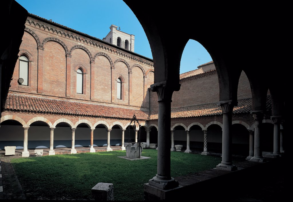 Stock Photo: 1899-47772 Cloister of San Romano, by Unknown, Unknow, Unknow. Italy, Emilia Romagna, Ferrara, former San Romano church, cloister. Foreshortened view cloister arches arcades porch: portico columns base shaft capitals well cortile interior garden roof tegole church bell-tower windows pilaster.