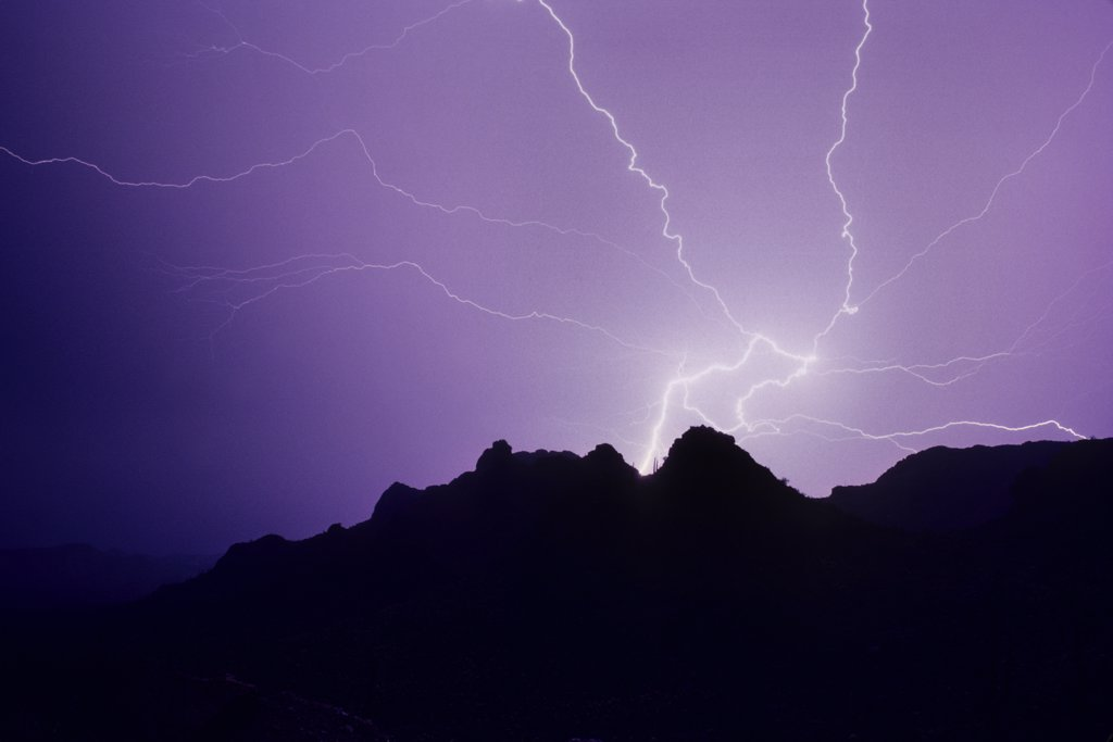 Dramatic lightning flash showing a powerful ground discharge with radiating air discharge channels.   Tucson Mountains, Tucson, Arizona, USA. : Stock Photo