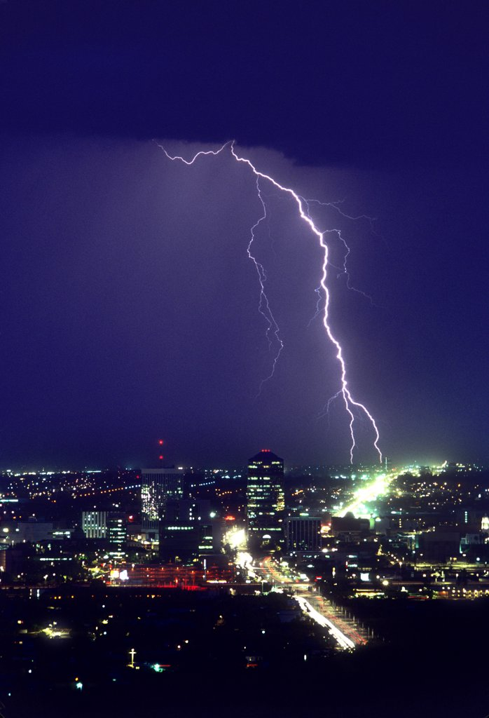 Stock Photo: 1899-49847 Storm over downtown Tucson, with two cloud-to-ground lightning strike points.   Tucson, Arizona, USA.