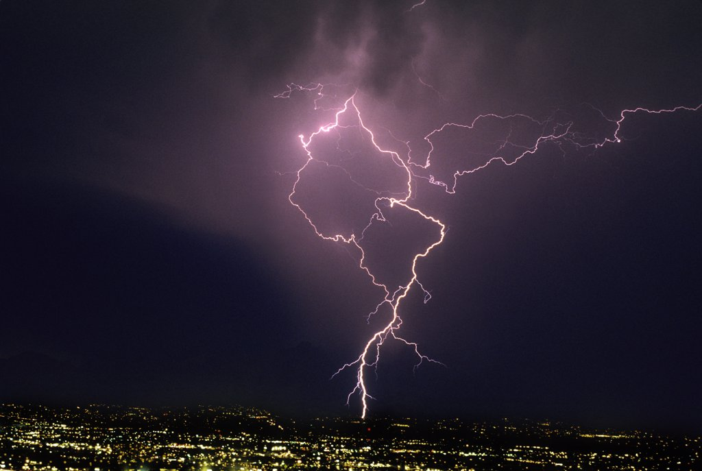 Stock Photo: 1899-49886 Ground discharge and cloud discharge lightning over city, illustrating lightning channel tortuosity.    Tucson, Arizona, USA.
