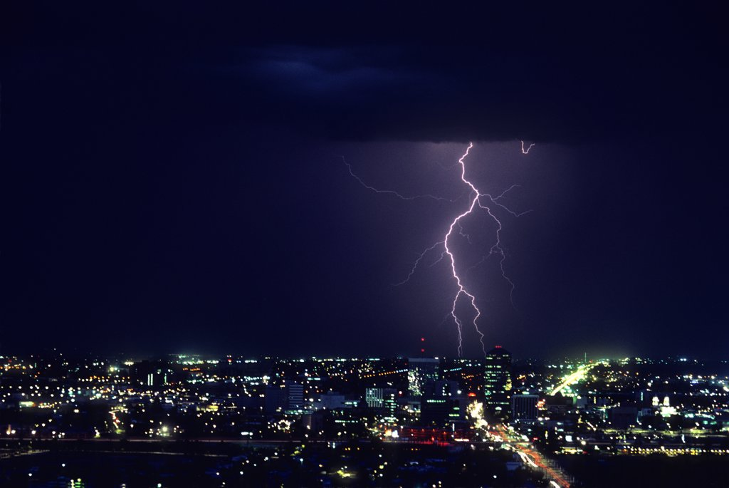 Stock Photo: 1899-49909 Ground discharge lightning with downtown Tucson in the foreground.   Tucson, Arizona, USA.