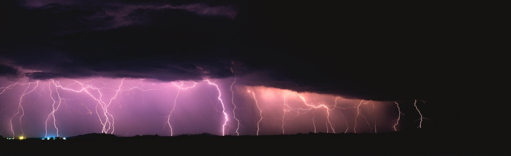 Stock Photo: 1899-50007 Widespread storm system with much cloud-to-ground lightning.   Marana, Arizona, USA.  Panoramic 6x17 film