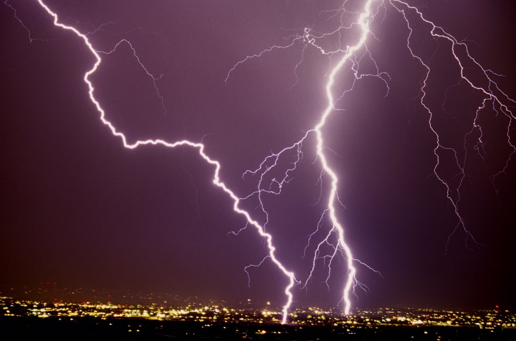 Stock Photo: 1899-50032 Two intense cloud-to-ground lightning strikes, one of which is an excellent example of zigzag lightning.   Tucson, Arizona, USA.
