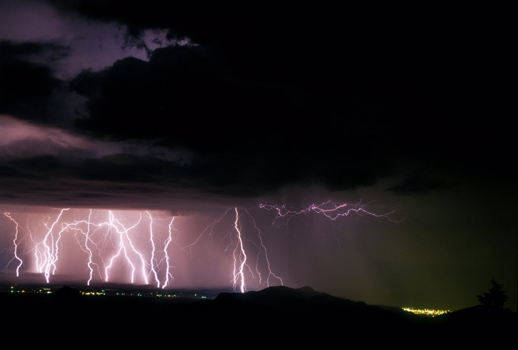 Stock Photo: 1899-50278 Active storm cell with multiple cloud-to-ground lightning strikes.   Near Socorro, New Mexico, USA.