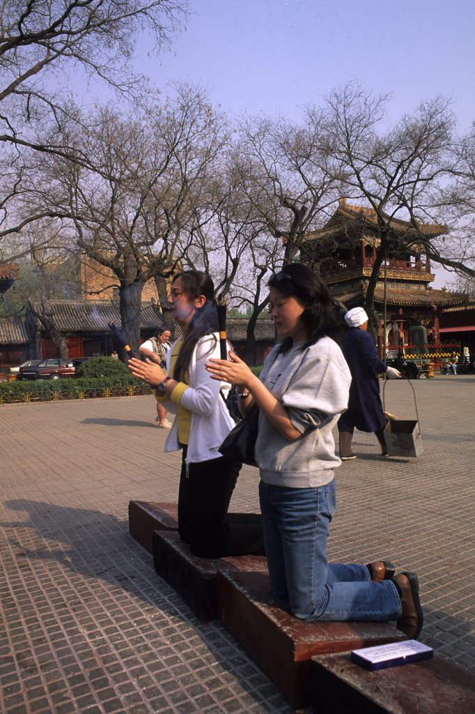 Stock Photo: 1899-51939 China, Beijing. Women Worshipping And Burning Incense At Lama Temple