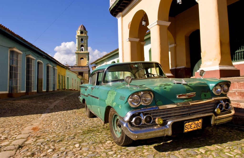 Stock Photo: 1899-52907 1958 Classic Chevy On Cobblestone Street In Center Square Of Trinidad, Cuba.
