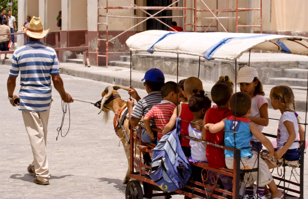 Local Children Celebrating With Goat Carriage Ride In Town Square In Santa Clara, Cuba : Stock Photo