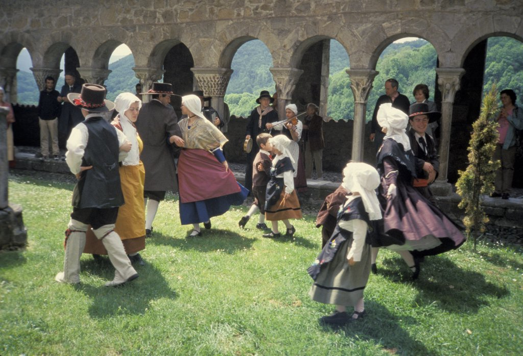 Stock Photo: 1899-53619 France. Pyrenees. St.-Bertrand-De-Comminges. Cathedrale Ste-Marie Cloister Garden. Cabeolum Folk Dancers.
