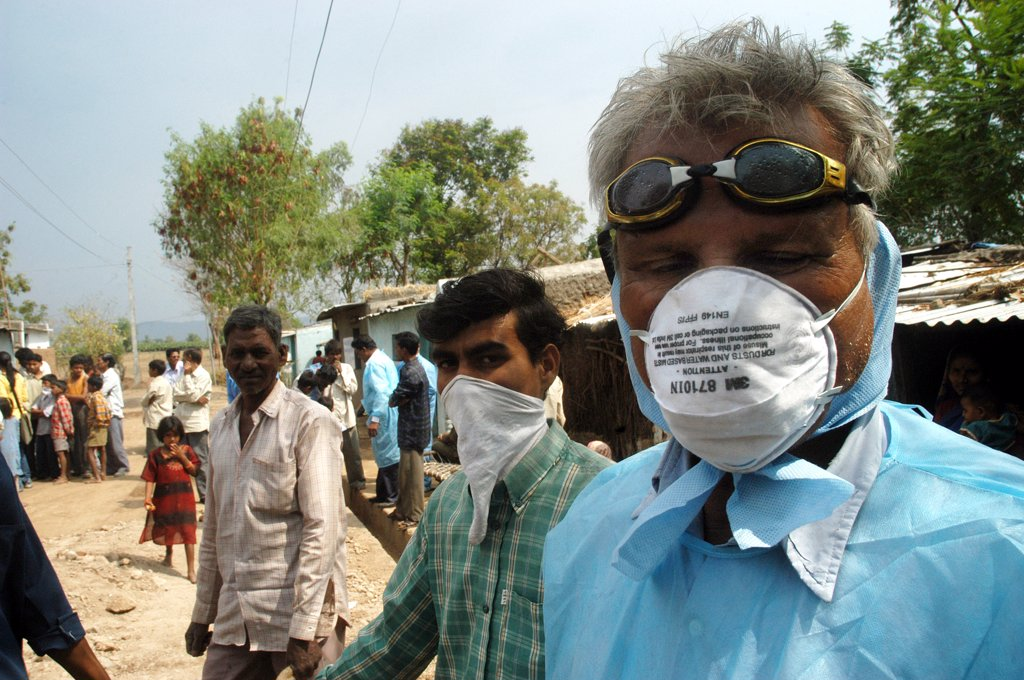 Stock Photo: 1899-54743 Health Workers Cover Their Faces With Protective Masks As The Go House To House To Cull Infected Chickens In The Backyard Of The Villager'S Houses At Hingona Village In Jalgaon District As Bird Flu Is Detected In Maharashtra, India