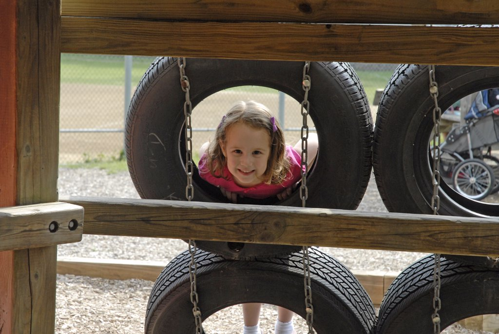 41/2 -Yr. Old Girl, Tires, Playground : Stock Photo