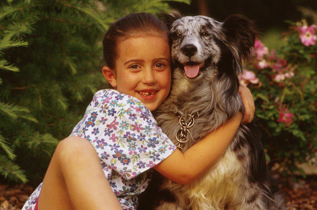 Girl Hugging Her Dog : Stock Photo