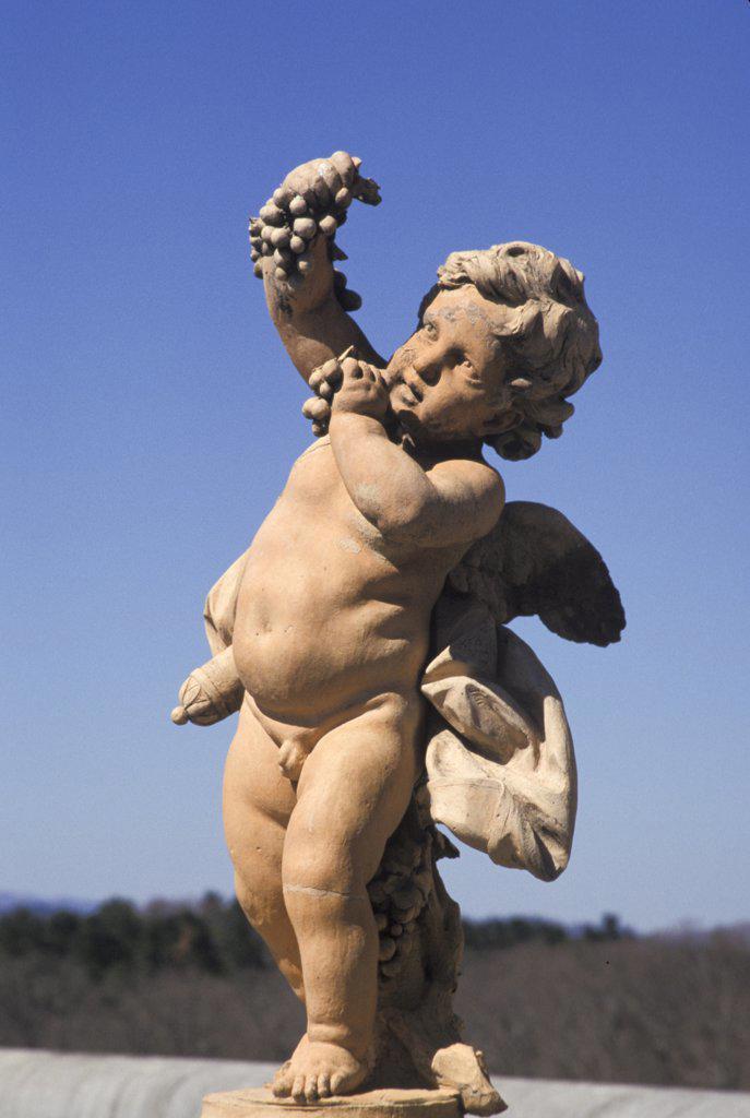 North Carolina, Asheville. Cupid Statue At Biltmore Estate. : Stock Photo
